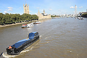 EXCLUSIVE<br /> loating art installation on the Thames – for a pricey £1.2 million.<br /> <br /> Art lovers are being given the chance to indulge in their craft by buying a floating art installation on the Thames – for a pricey £1.2 million.<br /> Immersive artwork Fluxland was launched down the river by renowned artist Cyril de Commarques as part of the Totally Thames festival.<br /> The mirrored superstructure is designed to reflect and distort the cityscape as she makes her way along the famous river, throwing light out at her onlookers.<br /> The remarkable boat, at Imperial Wharf, Fulham, is now on the market with the hefty price tag.<br /> Fluxland offers a unique opportunity to own a genuine work of art which has been built to be an artist's studio which can be lived and worked on.<br /> The accommodation includes a wheel house, internal mezzanine viewing deck, two double bedrooms – one with en suite – fully-fitted kitchen and a large open gallery / performance space and study.<br /> The interior features use of steel and concrete with huge expanses of glass offering views of the City as the occupier works, entertains or relaxes.<br /> ©Exclusivepix Media