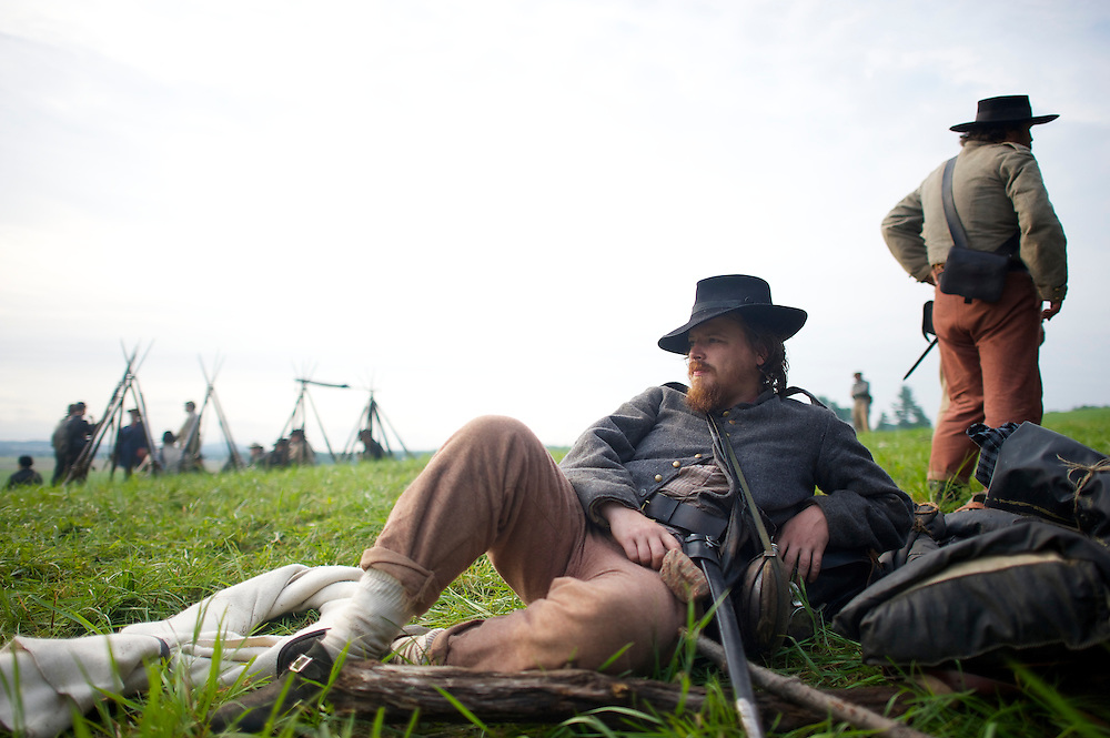 Geoff Roecker, from Brooklyn, New York City, of the Constitution Guard, lounges in camp the morning of the final day of the Blue Gray Alliance reenactment during events marking the 150th anniversary of the Battle of Gettysburg, in Gettysburg, Pennsylvania on June 30, 2013.