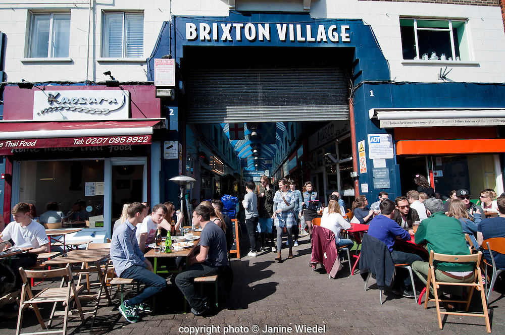 The gentrification of Brixton in the Brixton Village Granville arcade  indoor market