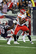Kansas City Chiefs tight end Demetrius Harris (84) catches a 7 yard first quarter touchdown pass that ties the score at 7-7 while covered by New England Patriots free safety Duron Harmon (30) and New England Patriots free safety Devin McCourty (32) during the 2017 NFL week 1 regular season football game against the New England Patriots, Thursday, Sept. 7, 2017 in Foxborough, Mass. The Chiefs won the game 42-27. (©Paul Anthony Spinelli)