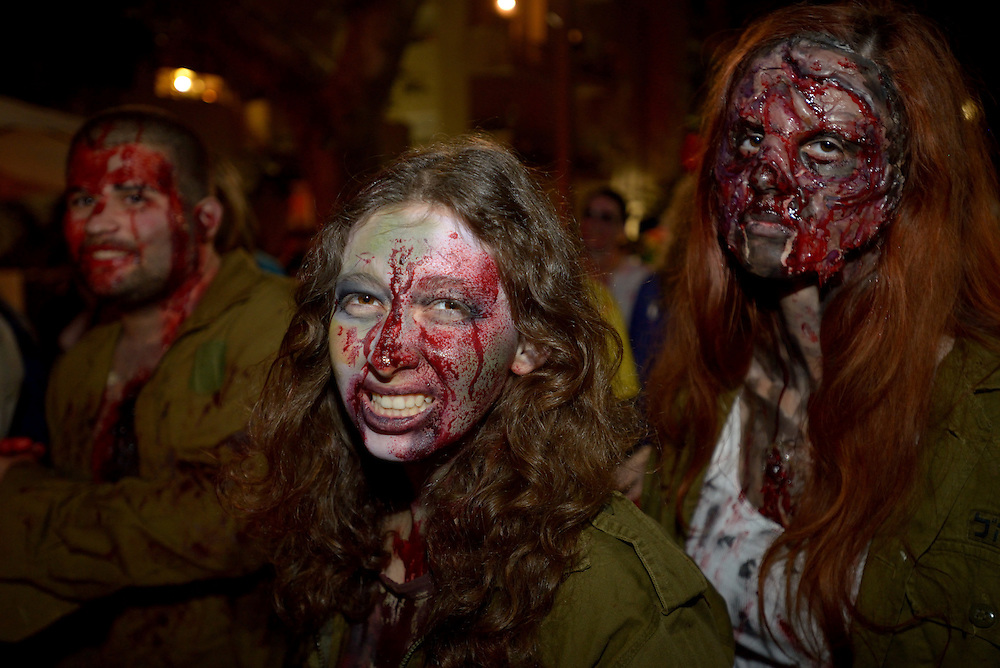 TEL AVIV, ISRAEL - MAR 15, 2014: Israelis wearing zombie make-up and wounded Israeli soldier costumes participate the Zombie Walk during the Purim festival in Tel Aviv. The Zombie Walk is held in tel Aviv during Purim Holiday in which Jewish traditionaly wear costumes. Photo by Gili Yaari