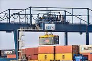 Nederland, Nijmegen, 27-1-2018Containerterminal Nijmegen, BCTN, container terminal, aan de Waal. Dit was in 1987 de eerste terminal van de bctn, binnenlandse container terminals. Er worden containers gelost met de kraan, containerkraan. Foto: Flip Franssen