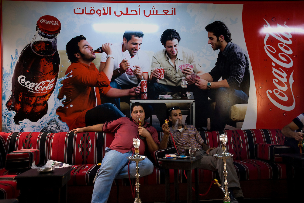 Palestinans smoke narguila pipe At the Eiffel cafe in Ramallah..Photo by Olivier Fitoussi