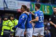 Portsmouth Players Celebrate  after Portsmouth Forward, Jamal Lowe (18) scores the opening goal 1-0 during the EFL Sky Bet League 1 match between Portsmouth and Scunthorpe United at Fratton Park, Portsmouth, England on 13 January 2018. Photo by Adam Rivers.