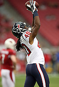 Houston Texans defensive back Marcus Williams (40) reaches high to catch a pass during pre game warmups before the 2014 NFL preseason football game against the Arizona Cardinals on Saturday, Aug. 9, 2014 in Glendale, Ariz. The Cardinals won the game in a 32-0 shutout. ©Paul Anthony Spinelli