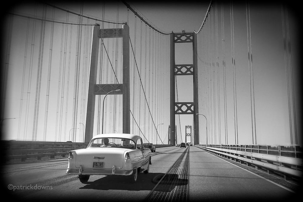 A '55 Chevy BelAir makes its way across the Tacoma Narrows Bridge towards Gig Harbor, WA.