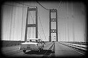 A '55 Chevy BelAir makes its way across the Tacoma Narrows Bridge towards Gig Harbor, WA.