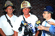 l to r: Chief James Campbell, Chief John Pally, and Building Commissoner Robert LiMandri at the Scaffling Collapse in Brooklyn leaving two injured and one dead in the Park Slope section of Brooklyn, New York on August 18, 2009..Workers finishing construction on The Ansonia Court Properties were drop approxiamately four-stories after riggings gave way and lead to the death of unknown worker and injuring two other workers in the Park Slope section of Brooklyn