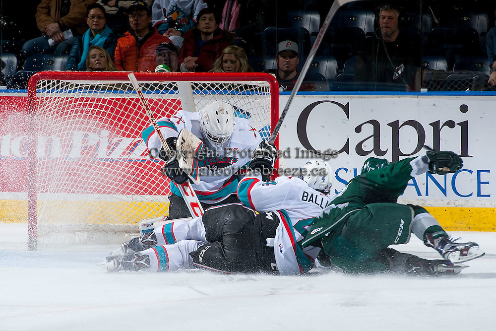 KELOWNA, CANADA - JANUARY 08: A player of the Everett Silvertips checks Gordie Ballhorn #4 into the net of Michael Herringer #30 of Kelowna Rockets on January 8, 2016 at Prospera Place in Kelowna, British Columbia, Canada.  (Photo by Marissa Baecker/Shoot the Breeze)  *** Local Caption *** Michael Herringer; Gordie Ballhorn;