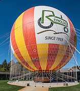 "On the 1859 Balloon Voyage at Conner Prairie Interactive History Park, visitors can ride a tethered helium balloon up to 377 feet (115 m) above the ground. The attraction is based on the historic August 17, 1859 trip of Aeronaut John Wise, where he made the first airmail delivery in the United States 25 miles (40 km) from Lafayette to Crawfordsville (Indiana) carrying 123 letters and 23 circulars. Wise was also the first to observe the jet stream, noting a ""great river of air which always blows from west to east."" Lifted by the largest tethered gas passenger balloon in the world (105 feet or 32 m tall), the gondola can carry up to twenty people. Manufactured by the French company Aerophile, only five of these balloons exist in the United States. Conner Prairie Interactive History Park provides family-friendly fun for all ages in Fishers, Indiana, USA. Founded by pharmaceutical executive Eli Lilly in the 1930s, Conner Prairie living history museum now recreates life in Indiana in the 1800s on the White River and preserves the William Conner home (listed on the National Register of Historic Places). This image was stitched from 2 overlapping photos."