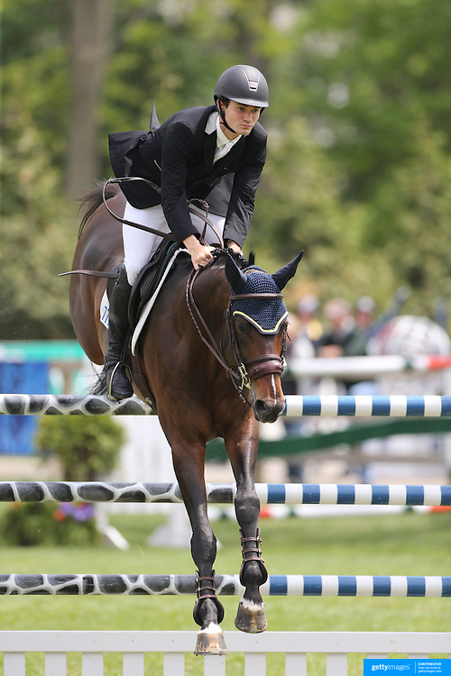 Richard Neal riding Quadam in action during the $35,000 Grand Prix of North Salem presented by Karina Brez Jewelry during the Old Salem Farm Spring Horse Show, North Salem, New York, USA. 15th May 2015. Photo Tim Clayton