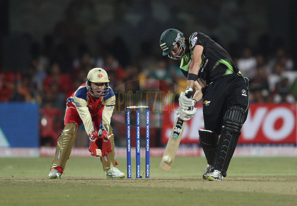 Johan Botha of the Warriors attacks a delivery during match 1 of the NOKIA Champions League T20 ( CLT20 )between the Royal Challengers Bangalore and the Warriors held at the  M.Chinnaswamy Stadium in Bangalore , Karnataka, India on the 23rd September 2011..Photo by Shaun Roy/BCCI/SPORTZPICS