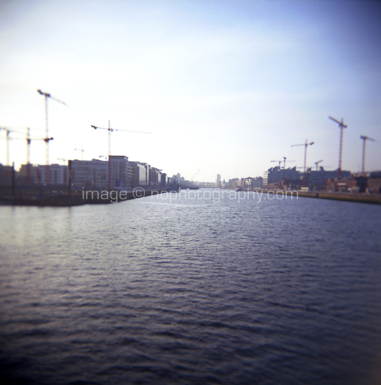 View up the River Liffey in Dublin Ireland from the East Link Bridge