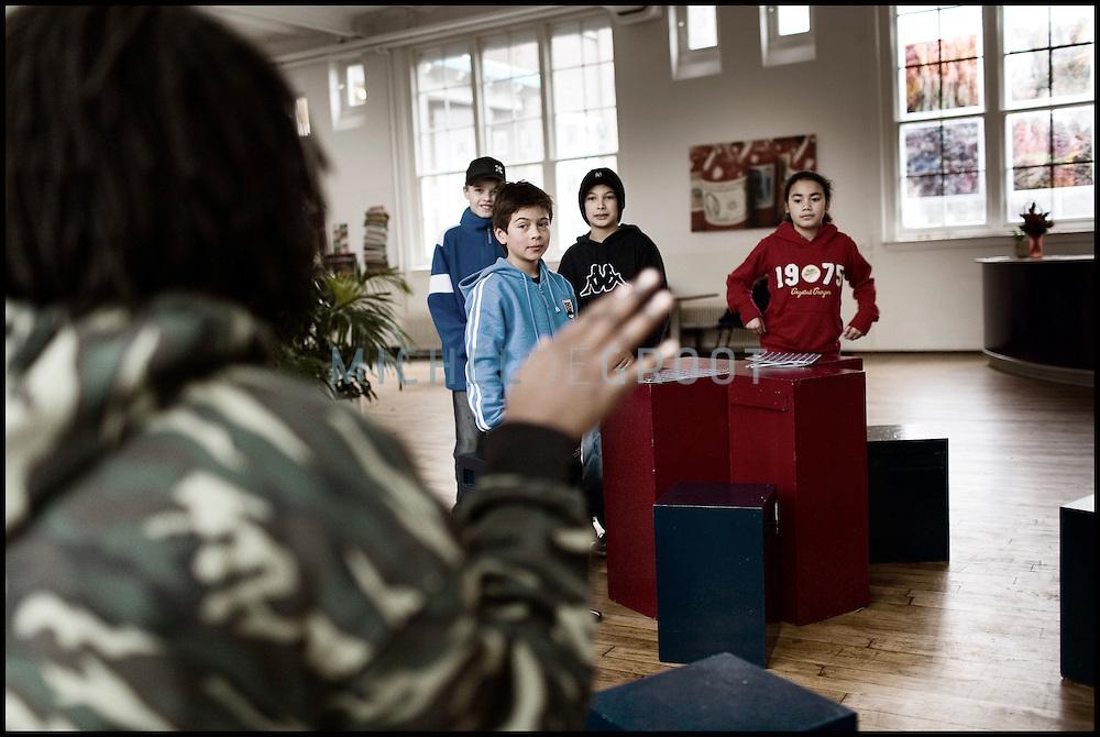 Professional rapper Wendell Weibolt teaches young students at the HipHop2 (quadrate) School in Arnhem in the Netherlands. At the Hip Hop school youngsters from 10 to 25 can take workshops in rap, hip hop, breakdance and DJ Spinning...In Arnhem is sinds januari 2006 een HipHopschool gevestigd. Op deze school kunnen jongeren van tussen de 10 en 25 jaar workshops volgen in Rap, R&B zang, Breakdance, HipHop dance en DJ Spinning. Dit iniatief is tot stand gekomen door een samenwerking van Stichting Interart en de Arnhemse Rapgroep ' Andere Gekte'.  Arnhem, NETHERLANDS - 15-2-06: