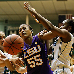 November 19, 2011; New Orleans, LA; LSU Lady Tigers forward LaSondra Barrett (55) battles loses possession as Tulane Green Wave forward Janique Kautsky (24) and guard Tyria Snow (25) defend during the first half of a game at Avron B. Fogelman Arena.  Mandatory Credit: Derick E. Hingle-US PRESSWIRE