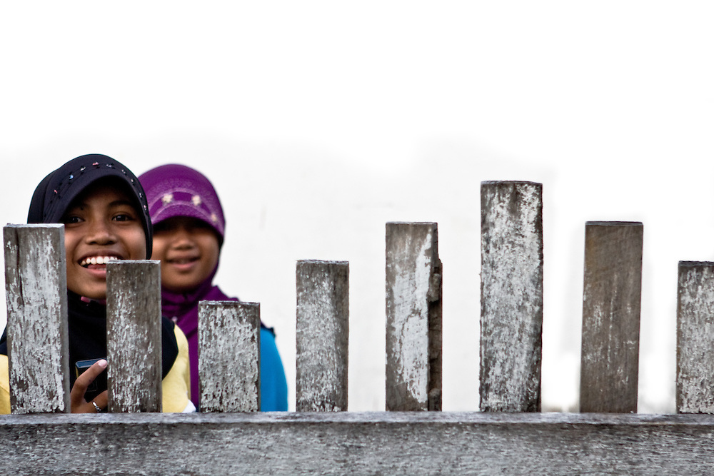 Two muslim girls in Luwuk, Indonesia, smile for the camera