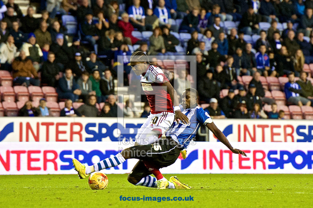 Hugo Rodallega of Fulham (left) is fouled by Leon Barnett of Wigan Athletic to win a penalty which was then converted by team mate Bryan Ruiz to make it Wigan Athletic 3 Fulham 3 during the Sky Bet Championship match at the DW Stadium, Wigan<br /> Picture by Ian Wadkins/Focus Images Ltd +44 7877 568959<br /> 01/11/2014