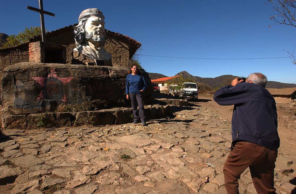 The image of Che Guevara stands for many things throughout Latin America, from a young traveler to an anti-U.S., anti-imperialist revolutionary. Two Mexican tourists take pictures in front of a giant bust of Guevara  in La Higuera, the town where Che was captured and killed.