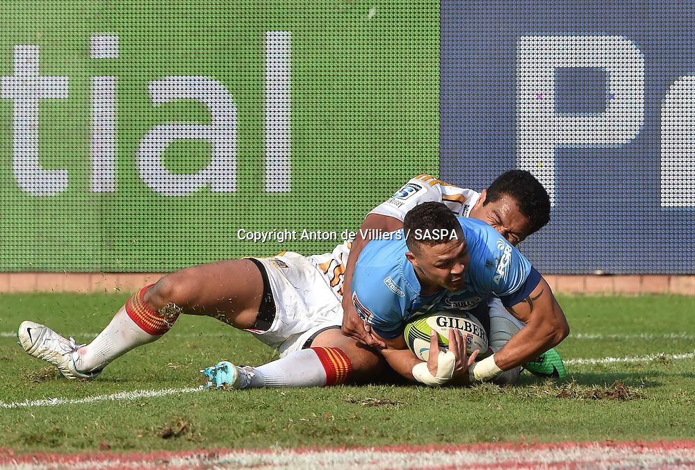 PRETORIA, South Africa, 29 MARCH 2014 : Bjorn Basson of the Bulls goes over for his try with Mils Muliaina of the Chiefs too late to stop him during the Vodacom Super Rugby match between the VODACOM BULLS and the CHIEFS at Loftus Versfeld in Pretoria, South Africa on 29 MARCH 2014. The game ended in a 34 all draw.<br /> <br /> &copy; Anton de Villiers / SASPA
