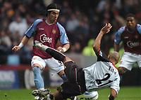 Credit: Back Page Images. Aston Villa v Fulham, FA Premiership, 23/10/2004. Juan Pablo Angel (Aston Villa) Zesh Rehman (Fulham)