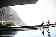 CAPE TOWN, SOUTH AFRICA, SATURDAY 7 April 2011, athletes run under the Chapman's Peak bridge during the 2011 Old Mutual Two Oceans marathon..Photo by ImageSA/Old Mutual