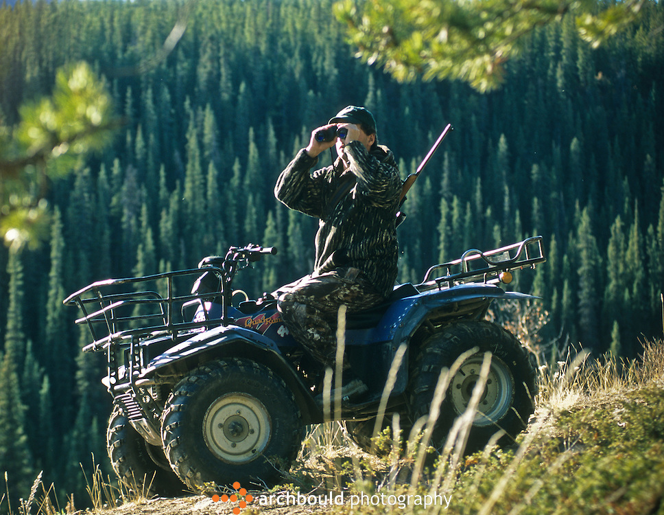 Hunting by ATV in Yukon, Canada.