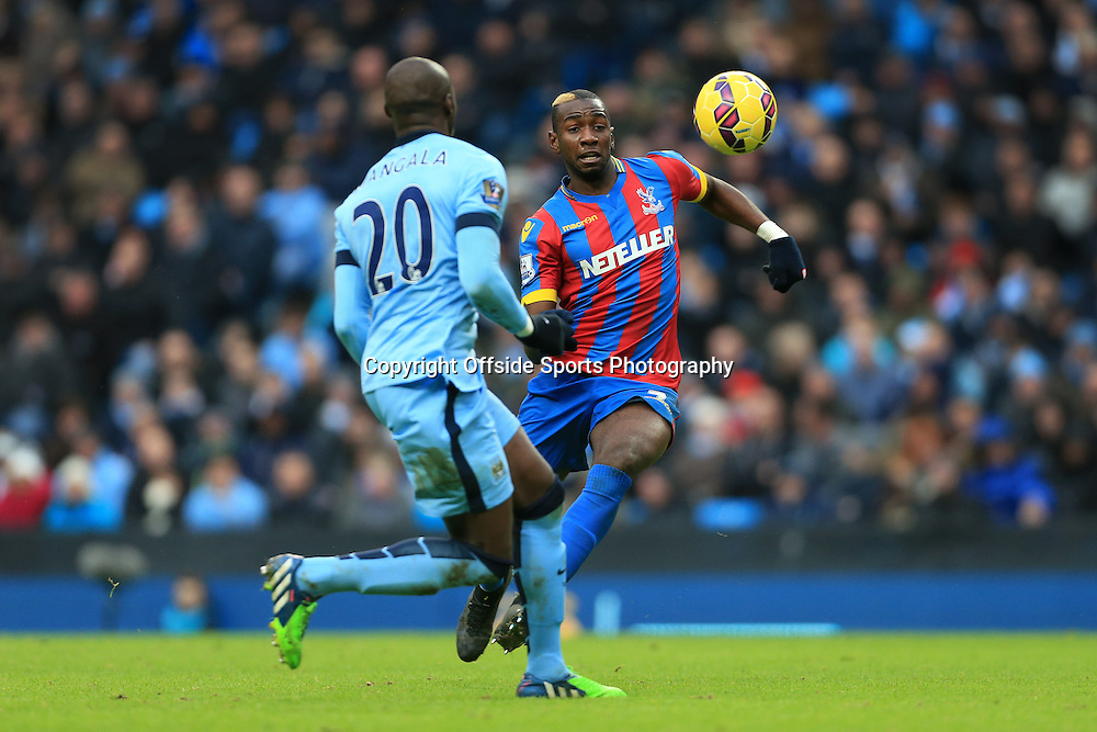 20th December 2014 - Barclays Premier League - Manchester City v Crystal Palace - Yannick Bolasie of Palace battles with Eliaquim Mangala of Man City - Photo: Simon Stacpoole / Offside.