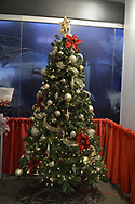 Garden City, New York, USA. November 24, 2018. The Long Island Festival of Trees is an annual holiday event at the Cradle of Aviation Museum on Long Island. All proceeds raised - including from sale of uniquely decorated Christmas trees and Department 56 porcelain village collection pieces, all donated - benefit the Cerebral Palsy Association of Nassau County, Inc.