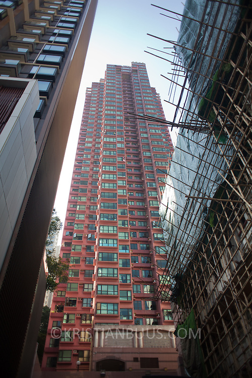 High rises tower high above street level letting very little light in below. Scaffolding made with bamboo covers one building. 7 million people live on 1,104km square, making it Hong Kong the most vertical city in the world.