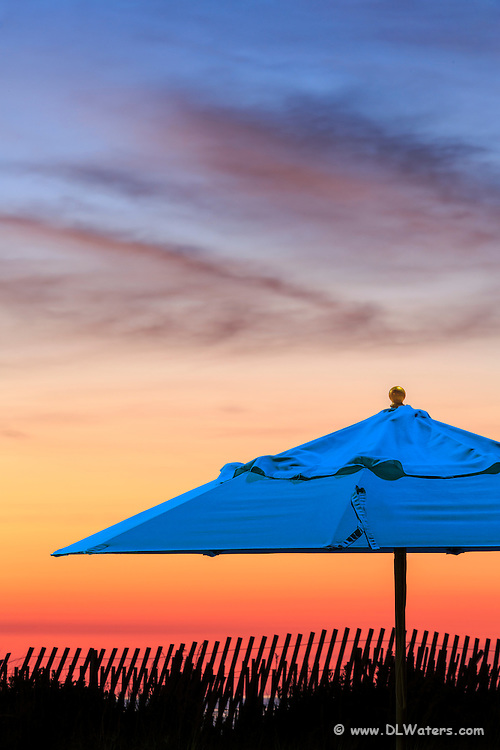 Beach umbrella at sunrise on the Outer Banks.