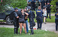 Person being arrested in New Orleans. After a fatal police shooting of Alton Sterling last week, there have been multiple protests. At least 48 people had been were taken into custody by midnight Sunday,