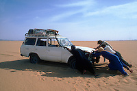 moving a 4X4 in the AlHoggar area, Sahara Desert, Algeria.2002..© Owen Franken......