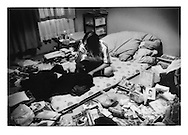 "Ryokei Namiki, a reovering ""hikikomori"" in the bedroom of his apartment, Gyotoku, Chiba, Japan...Hikikomori, which in Japanese means ""pull away"" are generally young men (80%) who isolate themselves from the outside world seeking shelter in their rooms often for years at a time."