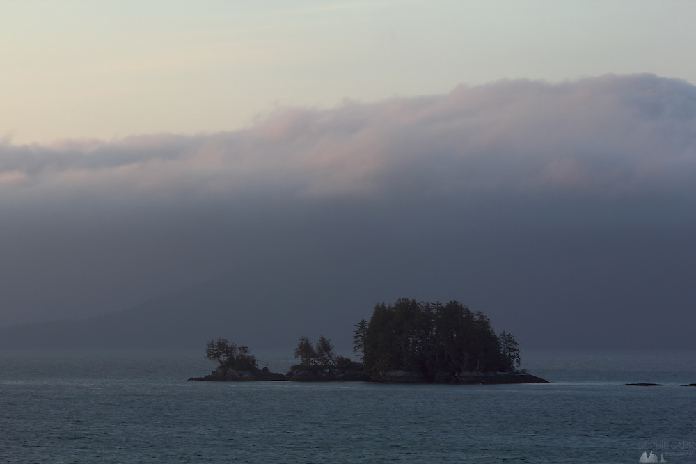 Sea fog clings to the mountains above small islands near Prince Rupert, at the top end of Canada's Inside Passage