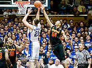 Duke Blue Devils forward Miles Plumlee (21) goes up inside as Maryland Terrapins guard/forward Cliff Tucker (24) tries to block his shot. Duke beats Maryland 71-64 at Cameron Indoor Stadium