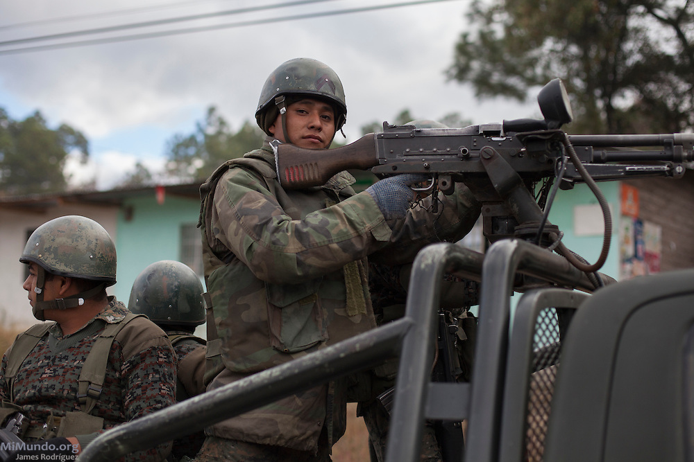 Soldiers from the 5th Infantry Brigade, stationed in Mariscal Gregorio Solares base, patrol outside the ancient Mayan site of Zaculeu on the last day of the Mayan era known as 13 Baktun. Zaculeu, Huehuetenango, Guatemala. December 21, 2012.