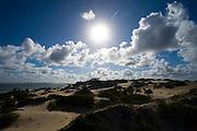 Sun shining over sand dunes on Lamu Island, Kenya, Africa