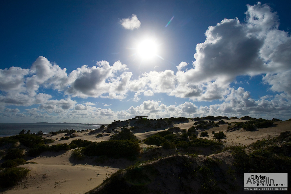 Sun shining over sand dunes on Lamu Island, Kenya, Africa