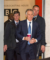 © Licensed to London News Pictures. 04/01/2018. London, UK.  Former British Prime Minister TONY BLAIR (C) flanked by security as he leaves BBC Broadcasting House following a Radio 4 interview. Mr Blair discussed the EU referendum and refuted claims in a new book that he shared rumours that the UK was spying on the Trump election campaign. Photo credit: Ben Cawthra/LNP