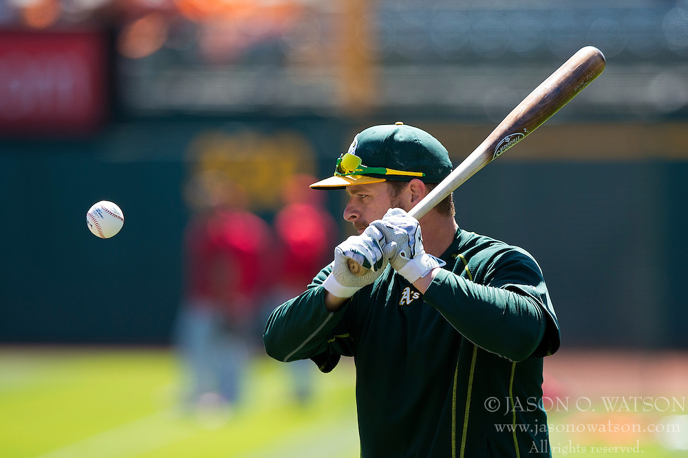 OAKLAND, CA - JUNE 21:  Stephen Vogt #21 of the Oakland Athletics hits ground balls during batting practice before the game against the Los Angeles Angels of Anaheim at O.co Coliseum on June 21, 2015 in Oakland, California. The Oakland Athletics defeated the Los Angeles Angels of Anaheim 3-2. (Photo by Jason O. Watson/Getty Images) *** Local Caption *** Stephen Vogt
