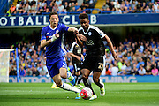 Leicester City Midfielder Demarai Gray (22) in action against Chelsea Midfielder Nemanja Matic (21) during the Barclays Premier League match between Chelsea and Leicester City at Stamford Bridge, London, England on 15 May 2016. Photo by Jon Bromley.