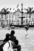 Tourists in front of the Plaza Mayor Fountain in Plaza de Armas Lima, Peru