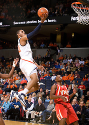 Virginia forward Mike Scott (32) skies to the basket against VMI.The Virginia Cavaliers defeated the Virginia Military Institute Keydets 107-97 in NCAA Basketball at the John Paul Jones Arena on the Grounds of the University of Virginia in Charlottesville, VA on November 16, 2008.