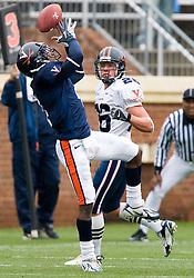 Virginia Cavaliers CB Vic Hall (4) intercepts a Marc Verica pass.  The University of Virginia Football Team played their Spring game at Scott Stadium in Charlottesville, VA on April 14, 2007.