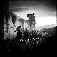 A parade of Angels passes by the former convent of Concepción during the Procession of Holy Mary of the Solitude on Holy Saturday. Antigua, Sacatepequez, Guatemala. April 19, 2014.