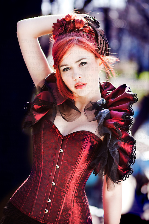 girl in red victorian corset with ruffle