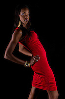 African American woman model posing with red dress.