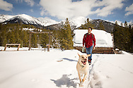 Woolrich Advertising of guy leaving winter cabin in Idaho to take his dog out for a walk.
