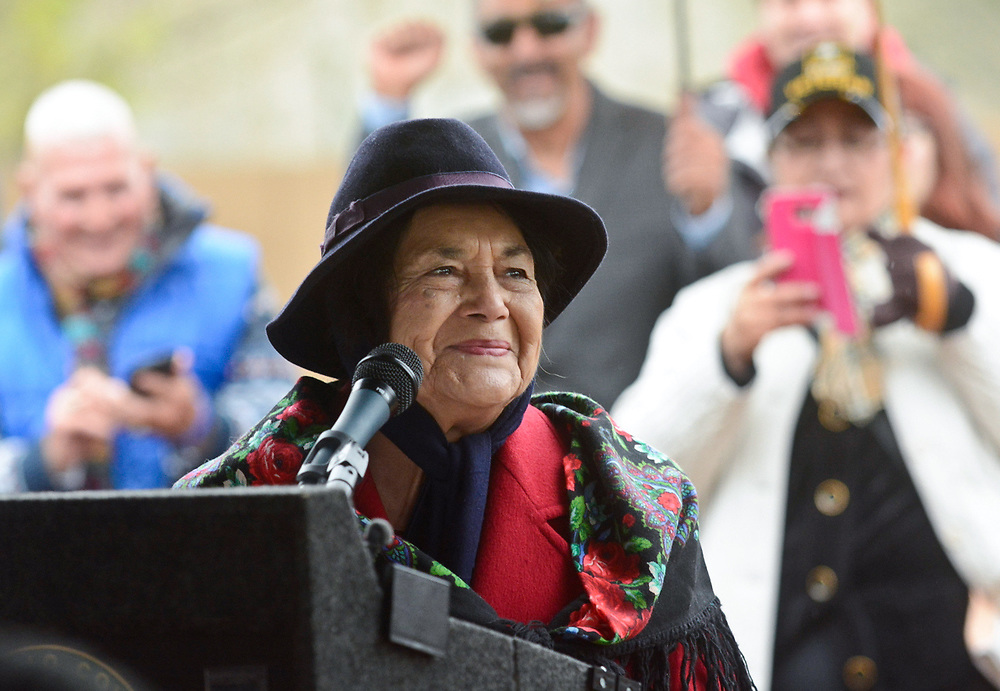 Dolores Huerta, the activist who started the National Farm Workers Association with Cesar Chavez, speaks during the naming ceremony for Dolores Huerta Gateway Park before the annual Cesar Chavez Day march, Saturday, April 1, 2017, in Albuquerque, N.M. (Marla Brose/Albuquerque Journal)