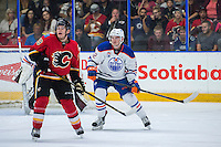 PENTICTON, CANADA - SEPTEMBER 17: Matthew Tkachuk #19 of Calgary Flames looks for the pass in front of Kyle Jenkins #92 of Edmonton Oilers on September 17, 2016 at the South Okanagan Event Centre in Penticton, British Columbia, Canada.  (Photo by Marissa Baecker/Shoot the Breeze)  *** Local Caption *** Matthew Tkachuk; Kyle Jenkins;